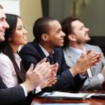 Business professionals applauding a presentation