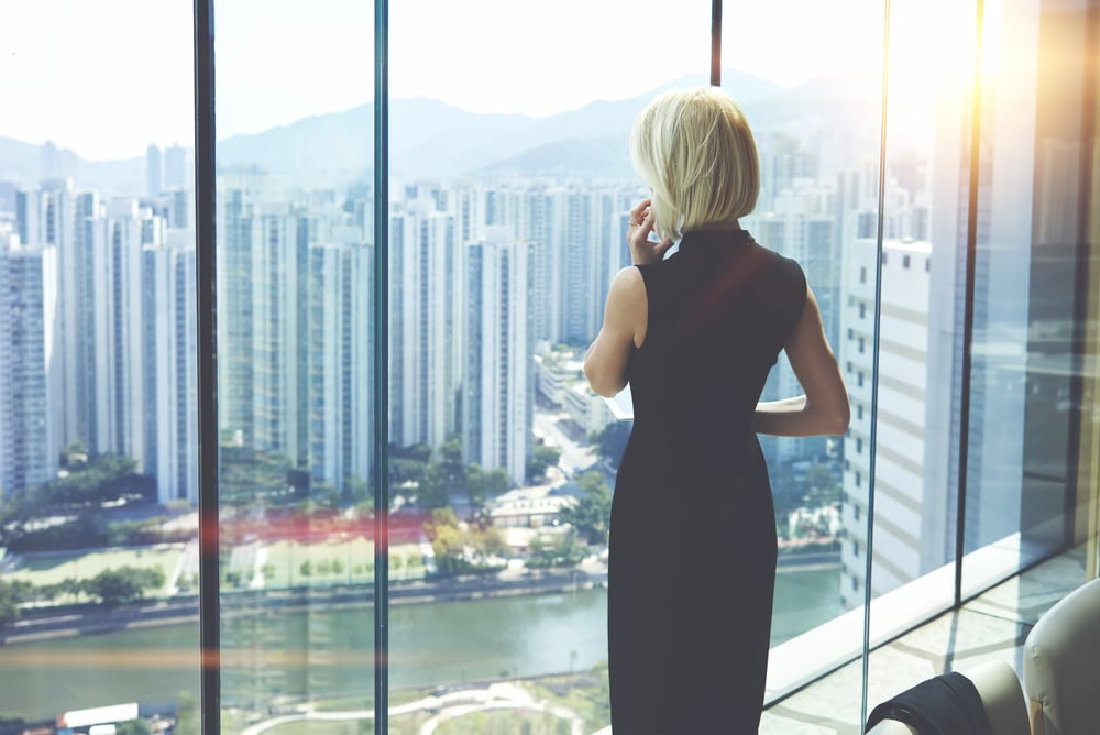 Business woman looking out office window