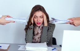 young business woman overwhelmed at work