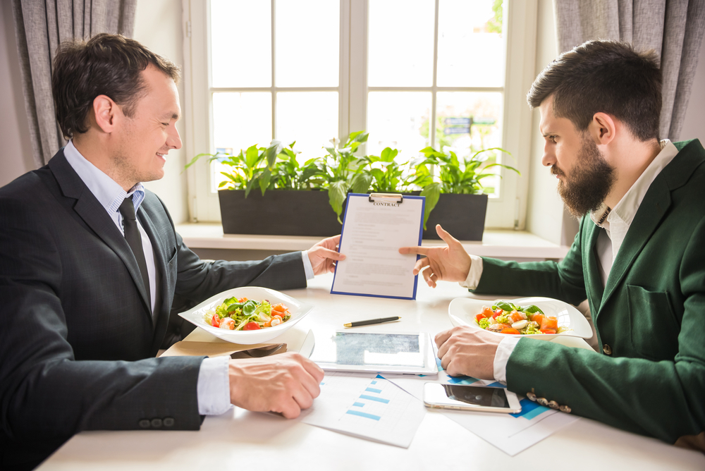 Two men having a discussion during a business lunch