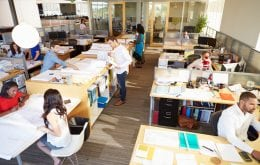 Employees working collaboratively in an open floor plan office