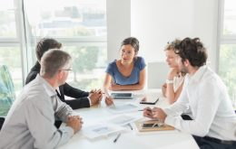 Female executive leading a meeting in temporary office space