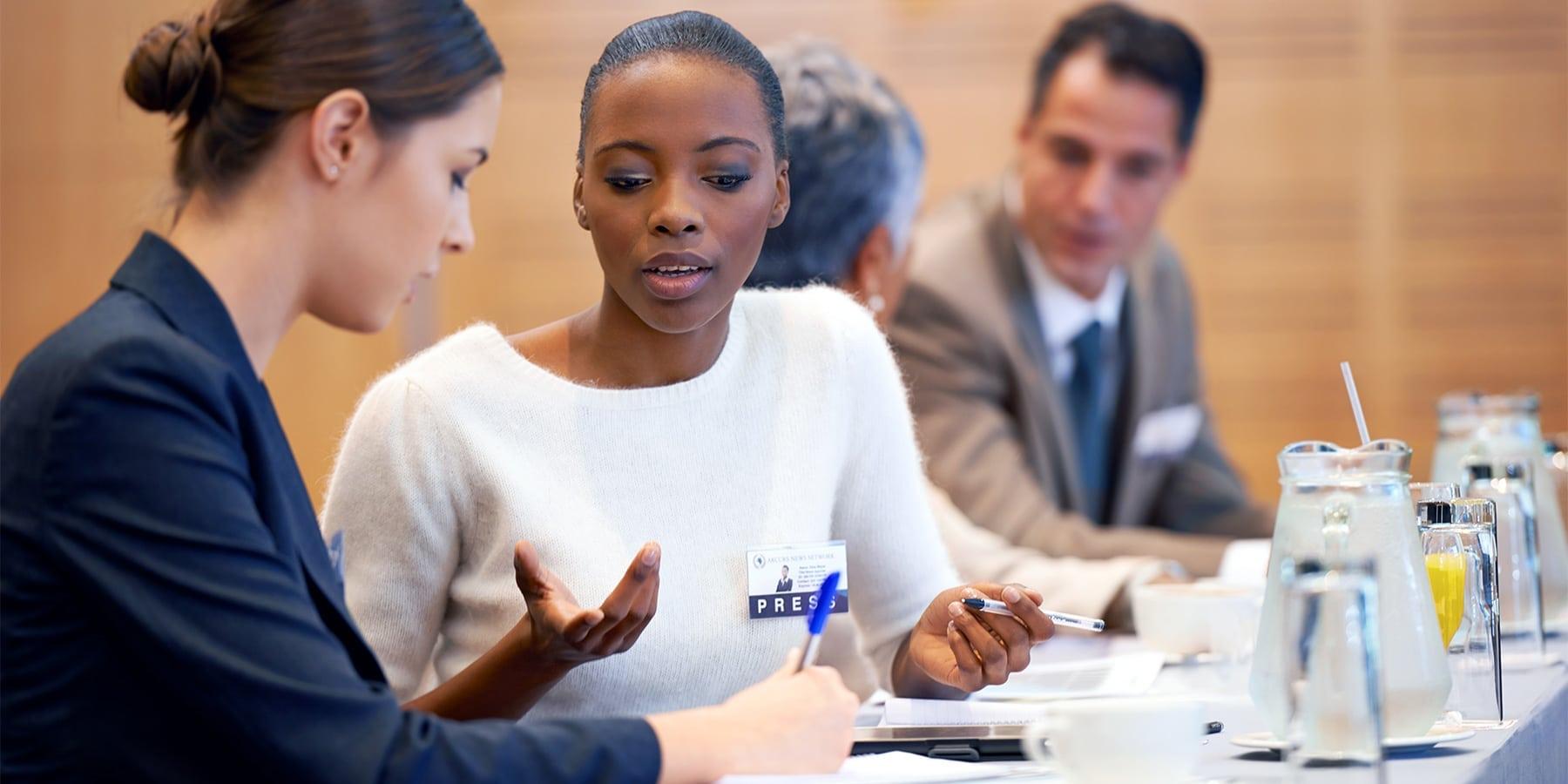 Female entrepreneurs speaking on a panel