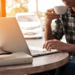 Frustrated freelancer working in coffee shop