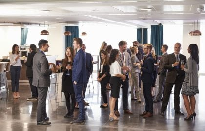 People interacting at an NYC networking event