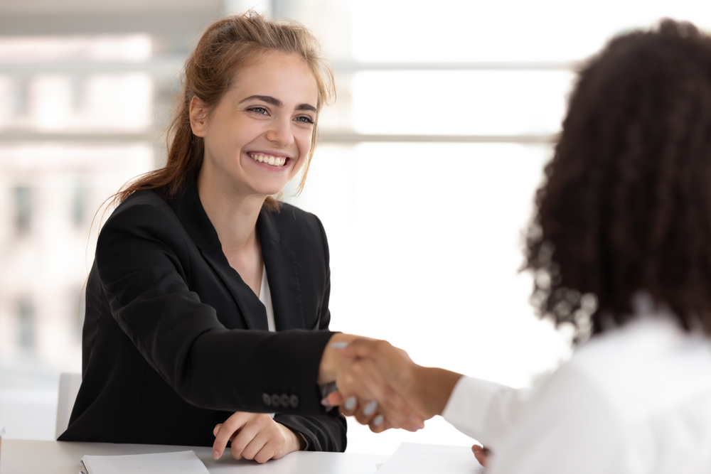 woman-shaking-hands-with-boss-after-negotiating-raise