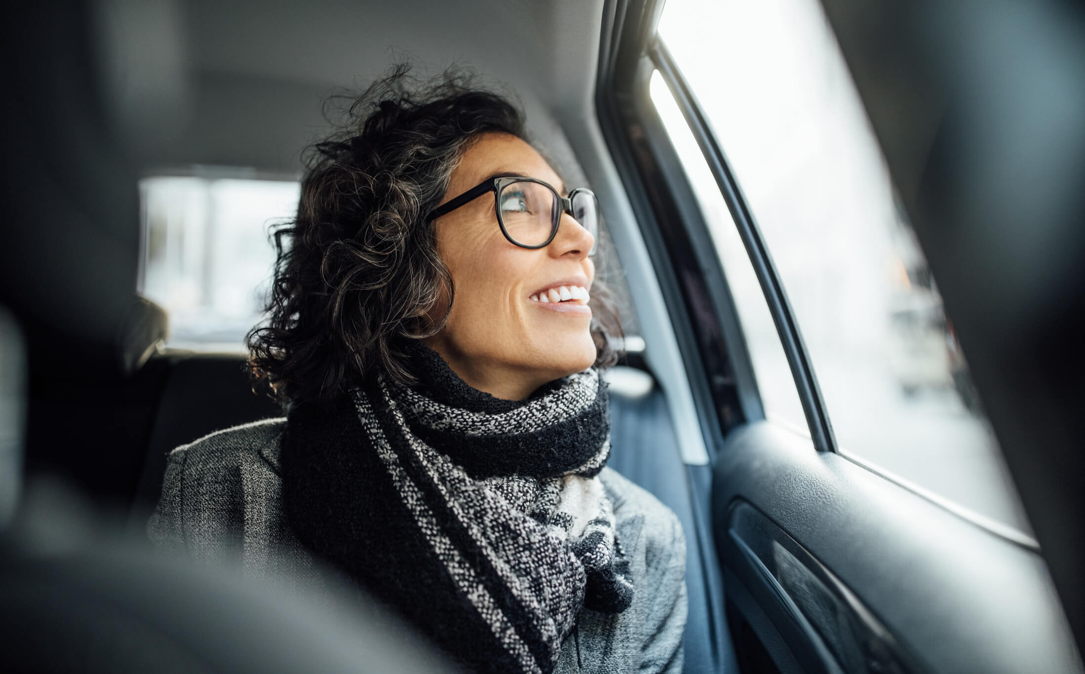 Female professional traveling via car for work